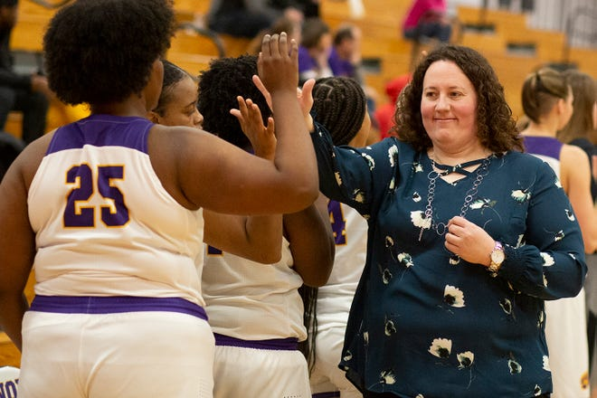 Knox College women's basketball coach Emily Cline high fives the members of her team after a 92-48 victory over Lincoln Christian University on Saturday, Dec. 14, 2019 at Memorial Gymnasium.
