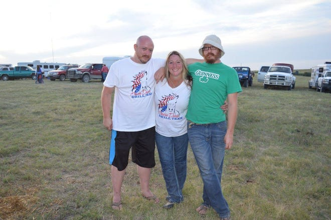 Jerremy Wilson and his twin brother Michael (in the green shirt, to the right) stand with their cousin Hollie Kendall at the Phillipsburg rodeo. The brothers, who grew up in Kansas but now live in Louisiana, make the trip back to the Phillipsburg rodeo each year.
