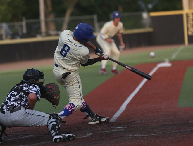 Hays Larks' player Leo Jiminian connects on a pitch during Hays' 10-4 win over the Denver Cougars on Friday. The Larks swept the three-game series.