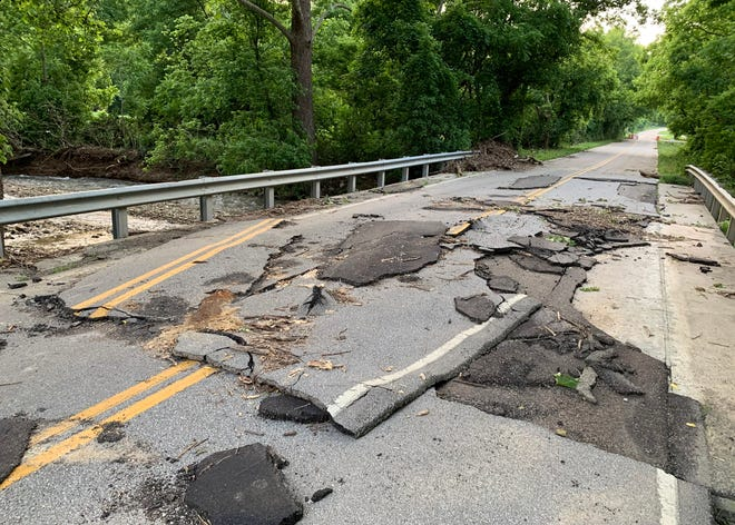 This bridge on South Rogers Street just northwest of Old Ind. 37 was closed over the weekend after a rushing Jackson Creek flowed over the bridge, lifting asphalt off the concrete deck.