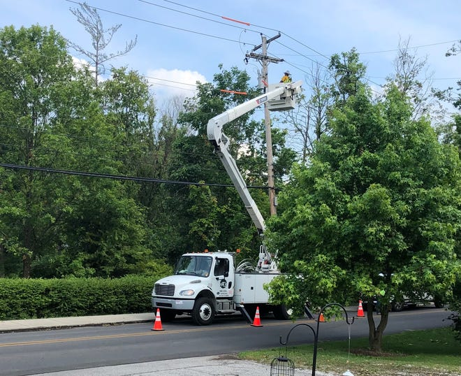 A utility crew works Sunday afternoon to restore power on South High Street, where electricity had been out since 8 a.m. Saturday. Service was restored at 6 p.m. Sunday.