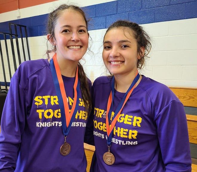 North Henderson's Glennin Hansen, left, and teammate Kaly Brookshire pose after Saturday's girls state wrestling invitational at Glenn High School.