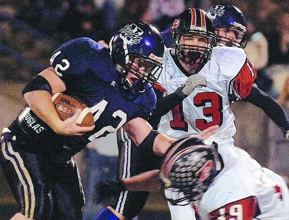 North Henderson fullback Canaan Cox fights for extra yardage during a game against Pisgah in this photo taken in 2007.