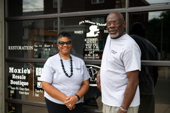 Andrea and Charles Miner pose for a outside of the Sunbeam building, where their boutique, Miner Things, is located on Monday, June 21, 2021. Miner Things will have a grand opening on June 30th.