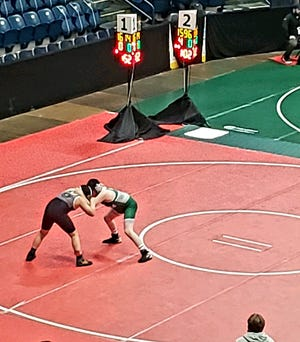 Luca Fontana, right, wrestles at the OAC Grade School Divisional Championships.