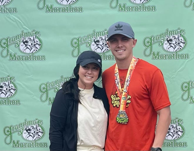 Lucas   VanNattan is pictured following the race with his fiance Taylor Churchill.