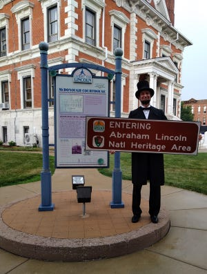 Abraham Lincoln (Michael Krebs) came to the McDonough County Courthouse on Friday to welcome the county as part of the Lincoln National Heritage Area.