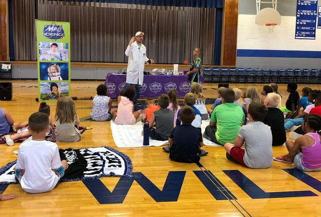 Little Dixie Regional Libraries received a grant from The Institute of Museum & Library Services  and administered by the Missouri State Library Association to bring an educational children's program named Mad Science free of charge to guests at both the Paris High School and Moberly Municipal Auditorium on June 16. Shown above is a Mad Science session held at Paris where more than 100 persons participated and learned through demonstrations about space, gravity, balance and wave lengths were among the science items taught.