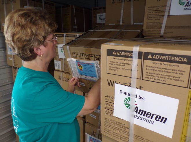 North East Community Action Corporation (NECAC) County Services Programs Director Linda Fritz looks over 80 air conditioners donated to the not-for-profit agency through Cool Down St. Louis and AmerenMissouri. The units will be distributed to NECAC clients who are elderly, disabled or have young children with health problems in counties served by Ameren. For more information, or to apply, call NECAC Randolph County Service Coordinator Patsy Redding at 660-263-6595. The NECAC Randolph County Service Center is at 1903 North Morley Suite B in Moberly.