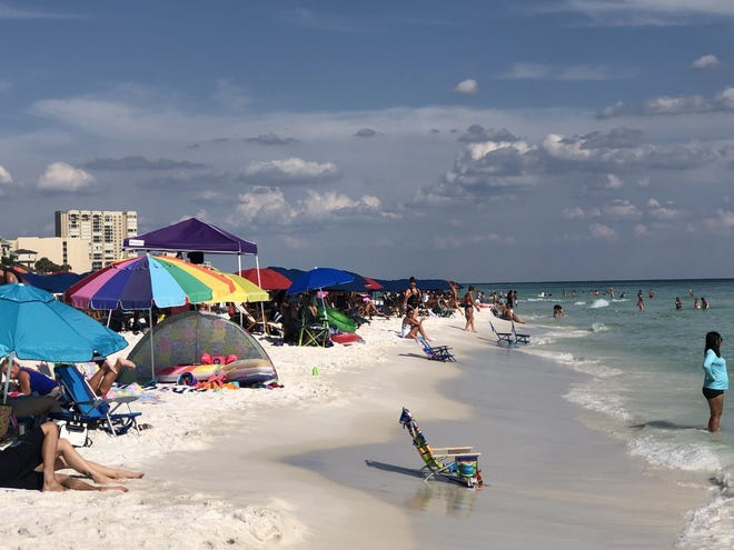 In this Daily News file photo, tourists jam a Walton County beach. The collectors of a bed tax in southern Walton County that funds marketing and other tourism-related initiatives are asking for a special meeting with the Walton County tourist Development Council to address a range of issues.