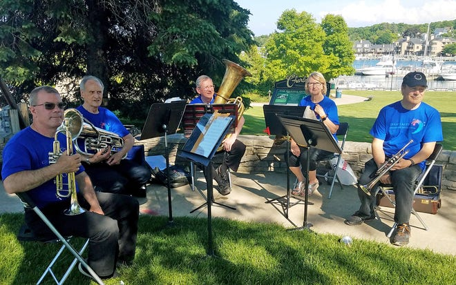 Great Lake Chamber Orchestra's Brass Quintet is pictured performing at the Charlevoix Summer Open House on June 10.