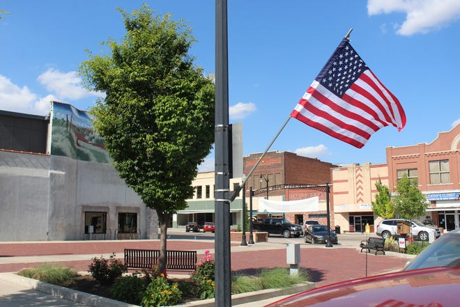 A flag waves in downtown Pratt, heralding Flag Day and the coming 4th of July celebrations in the community.