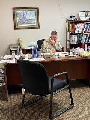 Bolen Office Supply co-owner Bob Bolen talking on the phone with a customer.