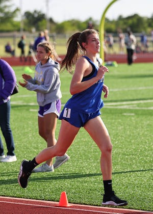 St. John Tiger Darby Smith runs long distance events at the Regional Track Meet earlier this spring.