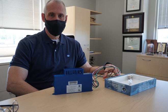 """Ron Orr, Pattonville School District's chief financial officer, isn't completely sold that the technology will keep students safer from covid-19. """"I will say, it makes our environment safer and healthier, because we're filtering out more from the air than we otherwise would be,"""" he says (Sarah Fentem / St. Louis Public Radio)"""