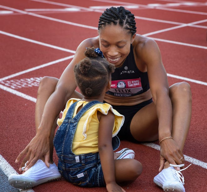 Two-year-old Camryn Ferguson shares a moment with her mother, Allyson Felix, on the track after Felix made the Olympic Team in the 400 meters during the U.S. Olympic Track & Field Trials at Hayward Field on Sunday.