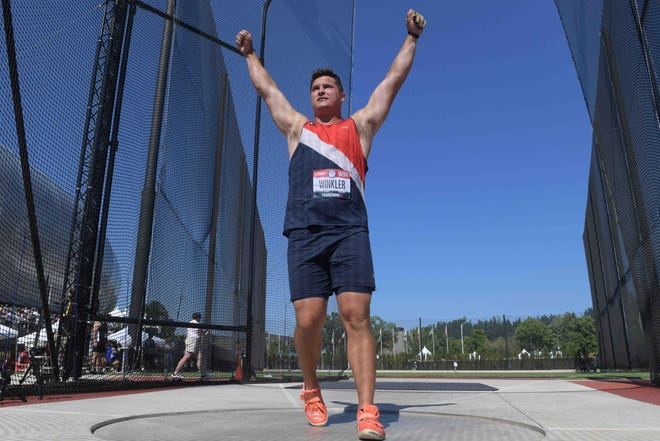 Rudy Winkler celebrates after winning the hammer with an American record of 271-4 at the U.S. Olympic Track & Field Trials on Sunday at Hayward Field.