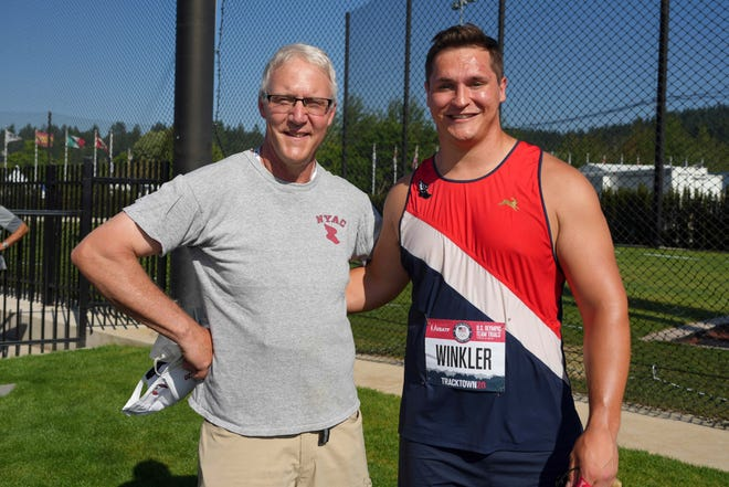 Rudy Winkler, right, poses with Lance Deal after breaking Deal's American record in the hammer with a throw of 271-4 on Sunday to win the event at the U.S. Olympic Track & Field Trials at Hayward Field.