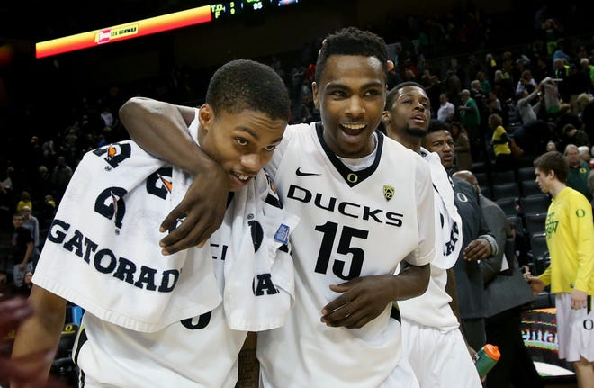 Oregon's Joseph Young and  Jalil Abdul-Bassit (15) celebrate the Ducks' 95-72 win over Washington State in February 2015 at Matthew Knight Arena. Young scored 29 points in the win. (Chris Pietstch/The Register-Guard)