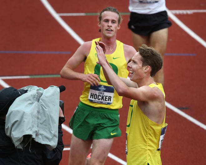 Oregon's Cole Hocker, left, greets champion Cooper Teare after the 5,000 final at the NCAA Outdoor Track & Field Championship meet earlier this month.