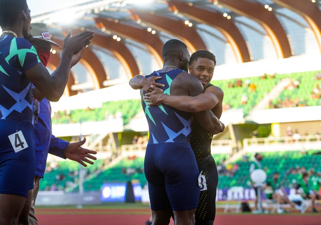 Oregon Ducks freshman Micah Williams gives Justin Gatlin a hug at the end of the men's 100 final at the U.S. Olympic Track & Field Trials at Hayward Field on Sunday.