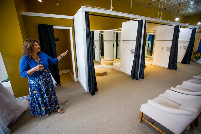 Owner Jennifer Shaum talks about the dressing rooms at Simply Yours Bridal in Granger. The bridal store will soon be moving from Toscana Park to a new location on Indiana 23.