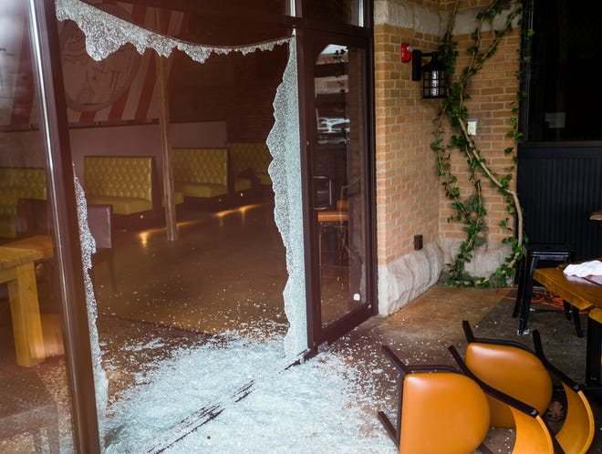 The interior of the Heavenly Goat Brewing Co., in Granger, as seen through a window in June, after a mass shooting in the parking lot.