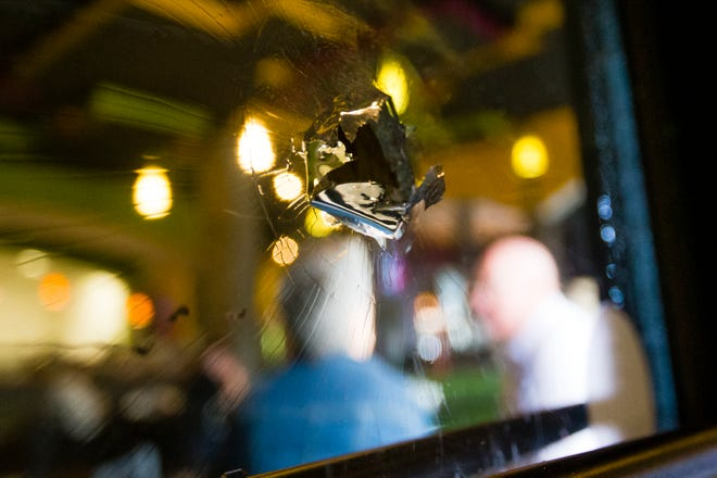 A bullet hole in an interior window at Uptown Kitchen in Heritage Square in Granger.