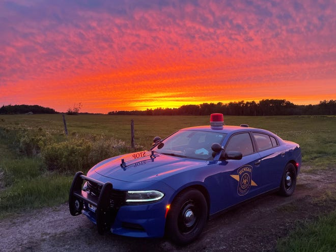 A Michigan State Police patrol car pictured with an Upper Peninsula sunset.