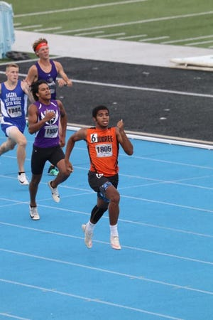 Kewanee High School's Melcon runs in the 2nd heat of the 400m Dash at this weekend's IHSA state track meet.