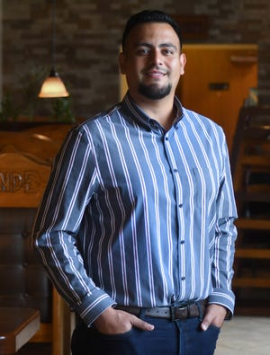 Emmanuel Ibarra stands in the dining room of the El Cerro Grande on Military Cutoff Rd. in Wilmington, N.C., Wednesday, June 9. 2021.  Ibarra and his father are the owners of the three El Cerro Grande restaurants in Wilmington and Ibarra is one of the StarNews 40 Under 40 honorees for 2021.