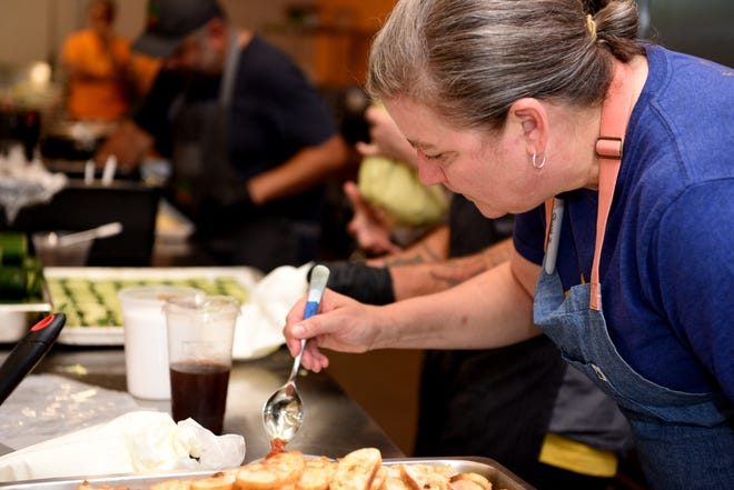 James Beard Award-winning chef Ashley Christensen plates a dish at the GLOW fundraiser on June 18, 2021, in Wilmington.