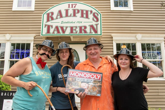 Monopoly game collector Bree Allard, left, patron Kendel Burdeaux, Ralph's Tavern owner Scot Bove, and bartender Hanna McEntee outside Ralph's Tavern on Shrewsbury Street, Monday, in Worcester.