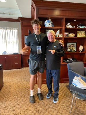 Monroe Freeling, a four-star 2023 offensive tackle from Oceanside Collegiate Academy in South Carolina (left), met with UNC football head coach Mack Brown during an unofficial visit last weekend. Freeling, the No. 10 tackle in his class, was also a standout performer at Saturday's selective UNC Showtime Camp.