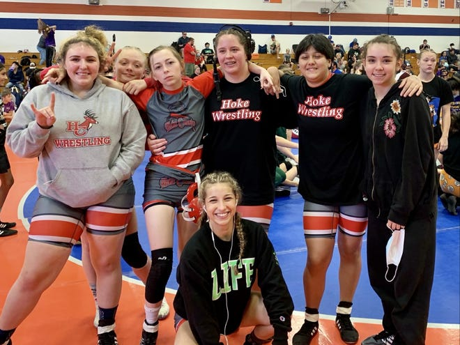 Hoke County High wrestlers celebrate their appearance at the NCHSAA Women's Invitational, the girls' wrestling state championships, held at Kernersville Glenn High on Saturday.