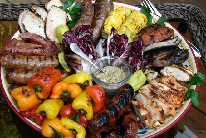 Tired of grilling burgers and hot dogs? A mixed grill with assorted sausages, vegetables and peppers offers a change of pace with multiple delicious options for everyone.