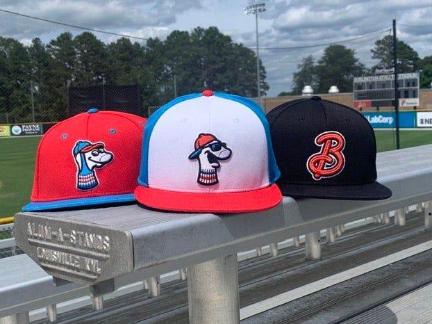 The Burlington Sock Puppets summer collegiate wood-bat team features a red, white, sky blue and black color scheme.