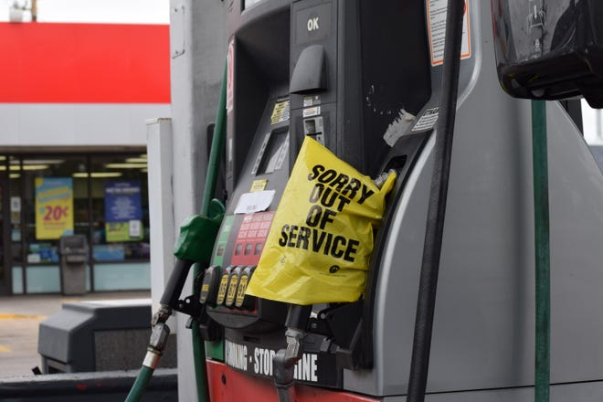 A plastic bag covers the pump of a local gas station to indicate it's out of service. Several Pueblo filling stations have been sold out of gas in recent days due to a nationwide shortage of tanker truck drivers.