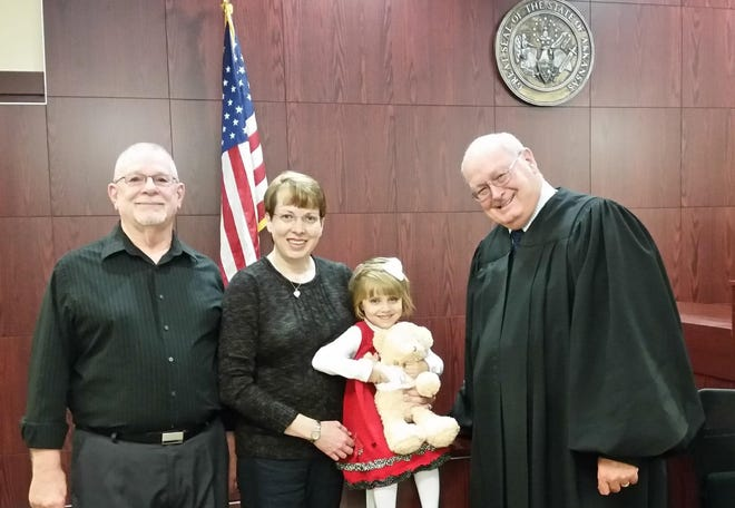 Judge Jim Spears, now retired, presides over Renate Drushal's adoption with Charles and Jill. The Drushals of Fort Smith died in a car crash Friday near Cameron, Oklahoma on their return from a trip to Alaska. Aaron Gamble and his son Landry were also killed in a separate car when the vehicles collided on Highway 112.