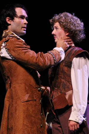 """Orsino (Rankin Dean) sizes up a young man who is Viola (Katie Macune) in disguise in this rehearsal scene from """"Twelfth Night,"""" one of two offerings in this year's Abilene Shakespeare Festival at Fulks Theatre this weekend at Abilene Christian University."""