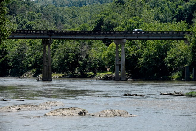 Scenes of the French Broad River June 21, 2021 from Woodfin River Park, where the Woodfin Wave will be located.