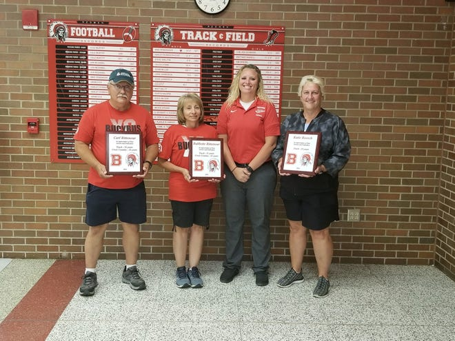 Bucyrus coaches Carl Rittenour, Babette Rittenour and Katie Roesch were honored at the high school on Monday as the trio retired from coaching the cross country and track programs.