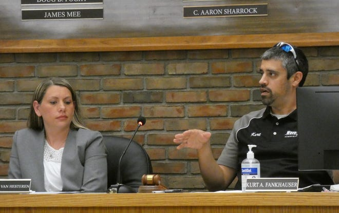 Rebecca Van Hesteren, left, who is serving as council clerk, listens as council President Kurt Fankhauser speaks during the June 16 meeting of Bucyrus City Council.
