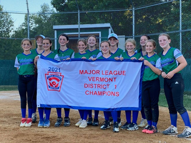 Members of the Colchester Little League softball team pose after winning the District I title on Sunday.