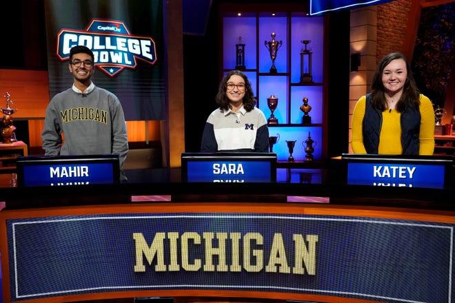 Mahir Piyarali, Junior, Sara Stawarz, freshman, Katey Salogar, freshman, represent the University of Michigan in the Capital One College Bowl.
