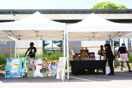 Vendors set up their stalls at the Third Thursday Market in Poe West on Friday, June 18, 2021.