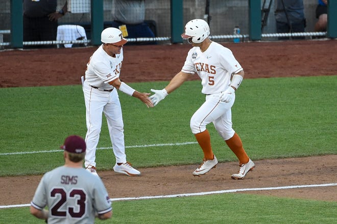 Texas outfielder Mike Antico is congratulated by head coach David Pierce as he rounds third base after hitting a home run against Mississippi State on Sunday. That made it a 2-1 game in the ninth inning; the Longhorns ended up losing by that score with the tying run on third base.