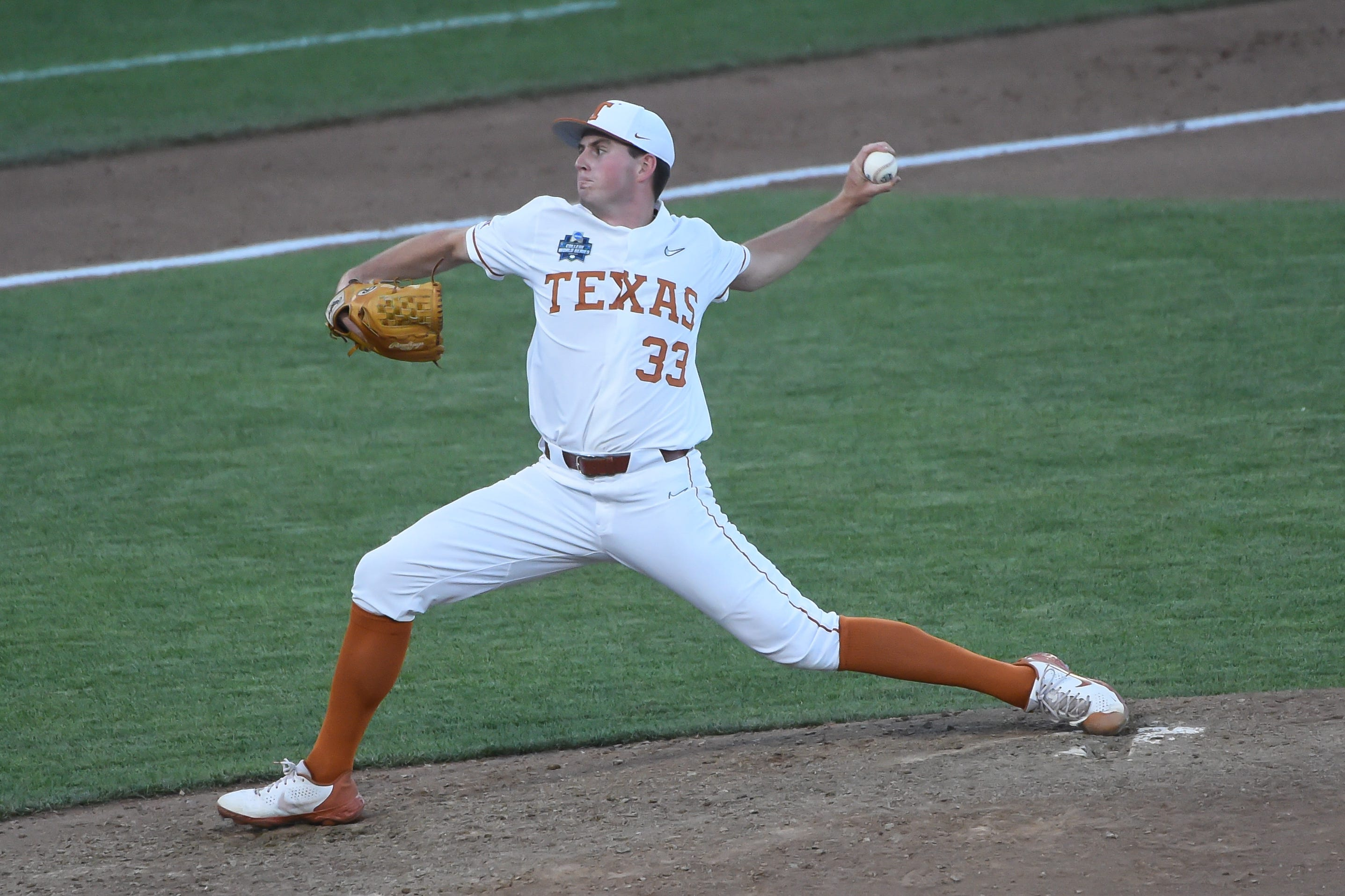 Jun 20, 2021; Omaha, Nebraska, USA; Texas Longhorns pitcher Pete Hansen (33) pitches in the eighth inning against the Mississippi State Bulldogs at TD Ameritrade Park. Mandatory Credit: Steven Branscombe-USA TODAY Sports