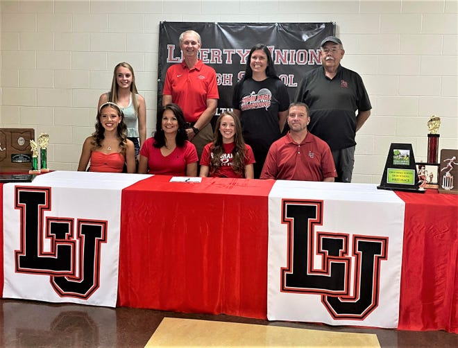Jayden Roach signed her letter of intent to run track and cross country for Rio Grande University. Roach, who broke several school records this season, is the 12th Liberty Union track athlete to sign with Rio Grande. Her dad was one of the first athletes to sign with their current coach. Seated from left to right: Jasmine Roach (twin sister), Melissa Young (mother), Jayden Roach, Jason Roach (father). Standing, L-R: Brittany Schmauch (Liberty Union assistant cross country coach), Bob Willey (Rio Grande head track coach, Krista Riddle, (Liberty Union assistant girls basketball coach) and Scott Williamson (Liberty Union assistant track coach).