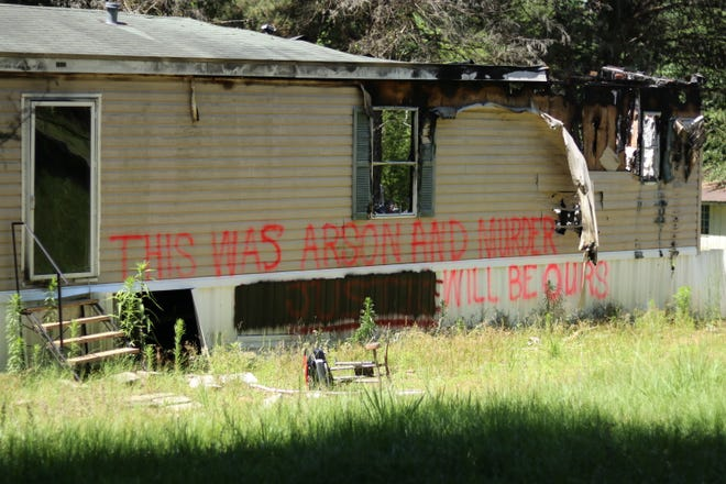 The charred remains of Kristina Michelle Jones' trailer have been covered in graffiti calling for justice. The Henley family believes that her mysterious death involved foul play.